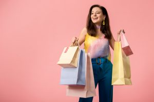 stylish woman with loads of shopping bags